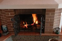 Remove dirt, soot and debris from your fireplace mantel with routine cleaning.