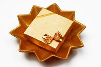 Present a child's golden birthday gift in a gold gift box.