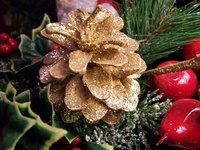 Create festive scented pinecones for Christmas.