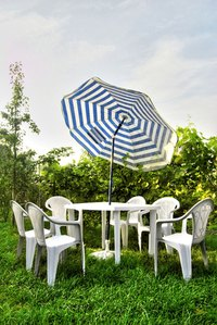 Protect a vinyl umbrella from the elements with a vinyl sealer.
