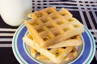 Prepare waffles for breakfast with a cast iron waffle maker.