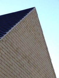 A gable roof with a shingle faced end.