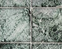 Leftover tile cement can stick to the surface of the tile, dulling the finish.