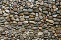 Applying creek rock fascia stones to your foundation can give it the look of a real stone wall.