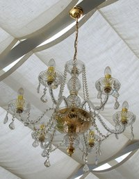 Spray cleaning a chandelier works well if it is done often enough.