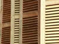 Protect your shutters from the weather by applying a wood sealer.