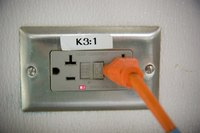 The electrical code requires GFCI outlets wherever there is water.