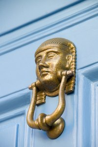 A polished brass door knocker adds charm to any door.