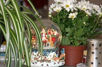 Keep the display uncluttered so the snow globes take center stage.