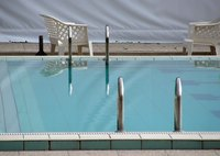 Avoid costly repair bills by fixing your pool tiles yourself.