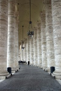 The curved columns of the Vatican are constructed from Travertine stone.