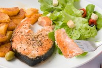 Grilled salmon is a traditional favorite.