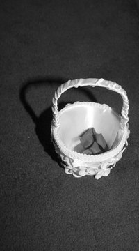 Add a personal touch to your wedding ceremony by making your own fabric flower girl basket.
