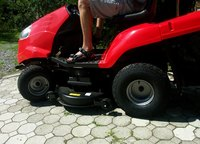 Most riding lawn mower wheels utilize snap rings and flat washers for retention.