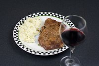 Grill a medium ribeye steak to create a simple and quick meal.