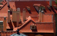 Cut roof tiles are crucial for coverage of buildings containing multiple peaks and valleys.