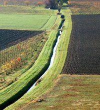 An irrigation ditch transports water to fields for flood irrigation.