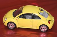 Give a miniature car first as a creative way to present the big gift.