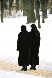 Nuns wear a veil, more commonly referred to as a habit.