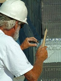 Stucco wire, or wire lath, is installed before the first coat of stucco.