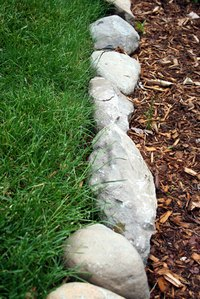 Rocks make natural borders for raised beds.