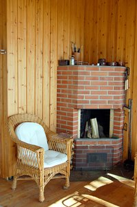 Keep a brick fireplace hearth in good condition by cleaning it regularly.