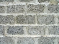 A cinder block wall built with mortar.