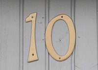 Some house numbers are attached with screws.