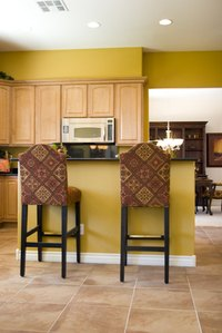 Flush-overlay cabinets add depth to a kitchen counter.