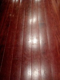 Use acrylic floor paint on wood floors.
