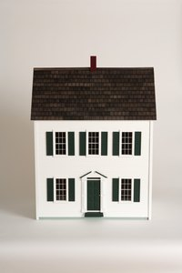 Add an elevator to a miniature dollhouse for added interest.