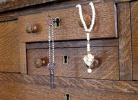 Line dresser drawers with felt to protect easily-scratched jewelry such as pearls.