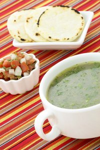 Serve plain arepas alongside soups and salads as you would bread.