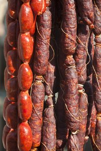 Sausage links can be tied off with string or simply twisted, depending on their casings.