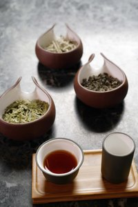 Bruising tea leaves helps them darken more quickly.
