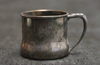 Sheet tin requires cutting, folding and seaming to make a tin cup.