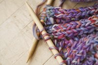 Loom knitting is easier for some people than traditional needle knitting.
