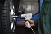 Loosening lug nuts is easier with an impact wrench.