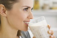 Woman drinking malted shake made with Horlicks