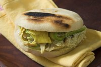 An arepa on a yellow napkin.