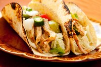 Shred the chicken and serve over tortillas for a mojo take on tacos de cazuela.