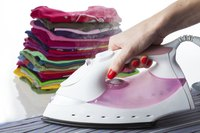 An iron with a dry setting is typically used to transfer appliques from paper to garment.