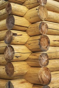 Log cabin walls are made solely of wood.