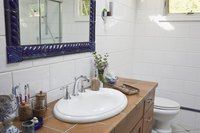Changing the mirror above the vanity and updating accessories give your bathroom a whole new look.