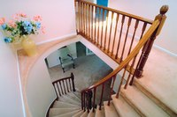 Cap-and-band installation is suited to fitting carpet to winding stairs.