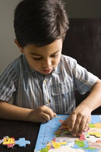 Preserve a child's favorite puzzle with decoupage medium.