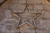 Decorative stars have an antique finish that makes them look old.