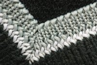 Mitered corners are used in a variety of projects besides blankets, as in this neck ribbing.