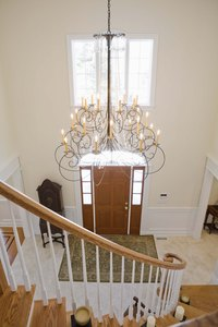 Chandelier placement is always important, especially on sloped ceilings.
