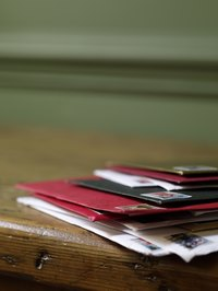 An envelope sealed with a personalized wax stamp makes a card stand out in a pile.